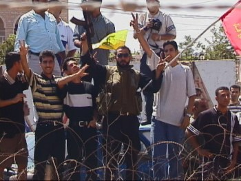 Hizbullah supporters celebrate on border during Israeli withdrawal, May 24, 2000 Hanson R. Hosein
