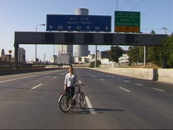 Heather enjoys the freedom of a Yom Kippur freeway in Tel Aviv, October 9, 2000, Hanson R. Hosein