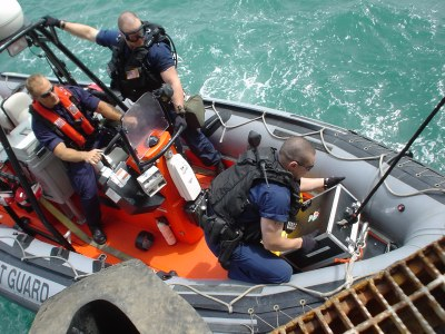 Coast Guard loading our NBC gear from MABOT onto Zodiac, HRH April 8, 2003