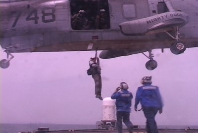 Hoisting me down from Desert Duck onto USCGC Boutwell, April 6, 2003 HRH
